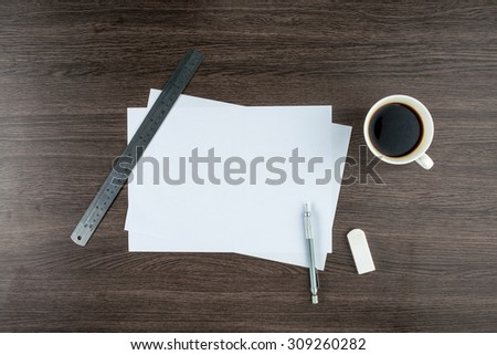 paper, Eraser Ruler and Mechanical pencil with cup of coffee