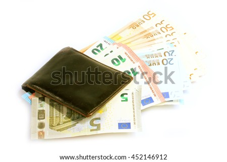 paper euro banknotes in old leather purse