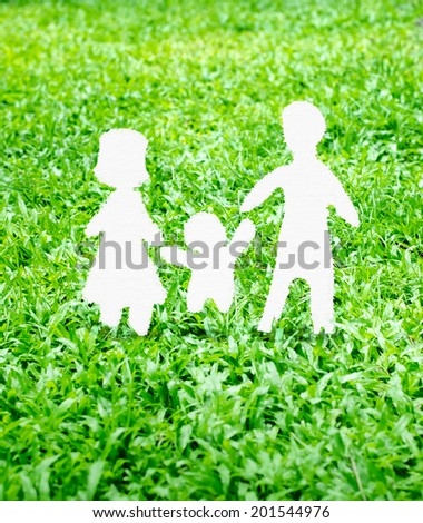 Paper Family icon on green grass - stock photo