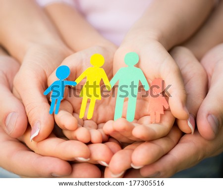 Paper family in hands - stock photo