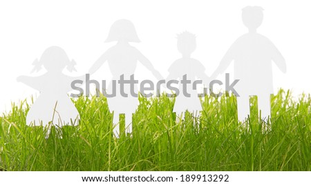Paper Family silhouettes in grass isolated on white - stock photo
