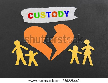 Paper family with broken heart and Custody text                                - stock photo