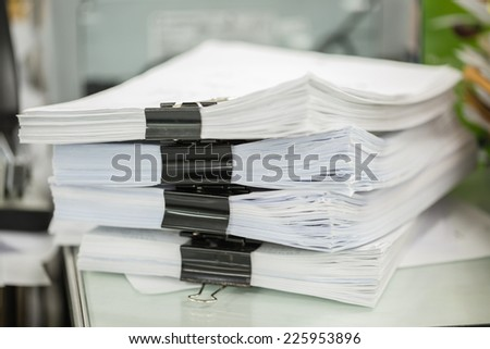 Paper files stacking up - stock photo