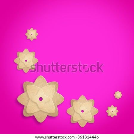 paper flowers on pink background. - stock photo