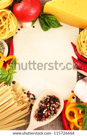 paper for recipes, spaghetti with vegetables and spices, on sacking background