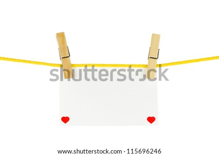 paper hang on clothesline with clipping path and little hearts