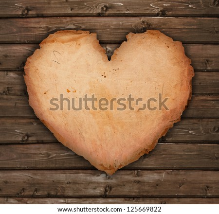 paper heart on a wooden table - stock photo