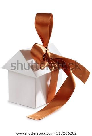 Paper house and ribbon on white background