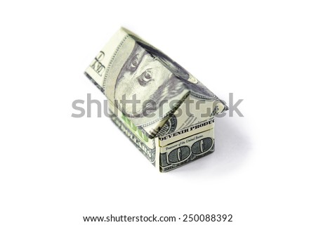 paper house made of 100 dollar banknotes - stock photo