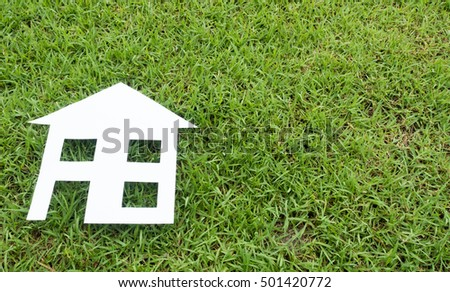 paper house on  grass close up