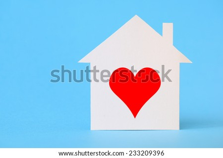Paper house with heart shape - stock photo