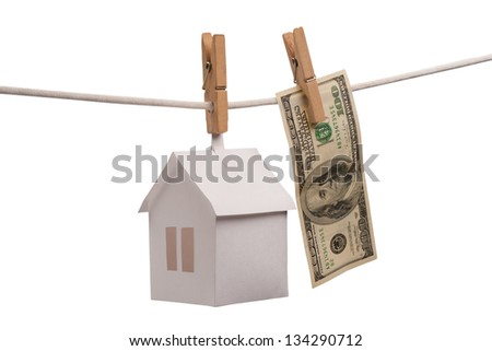 Paper houses with clothespins, on isolated on white background. - stock photo