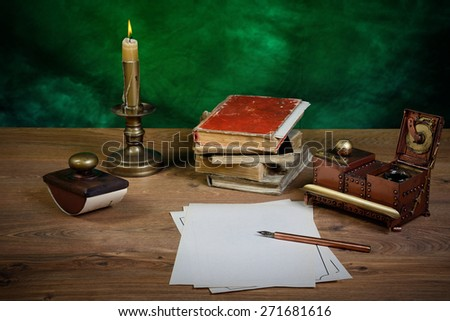 paper, ink pen, inkstand and paperweight on  table. - stock photo