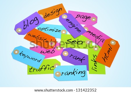 paper labels of different colors with different words about the search engine optimization and internet concepts - stock photo