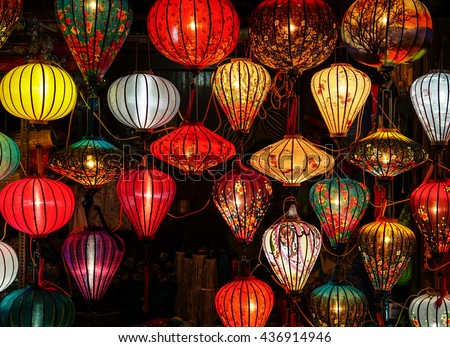 Paper lanterns lighted up on the streets of an Asian town