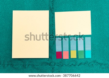 Paper memo stick on green wall background. - stock photo