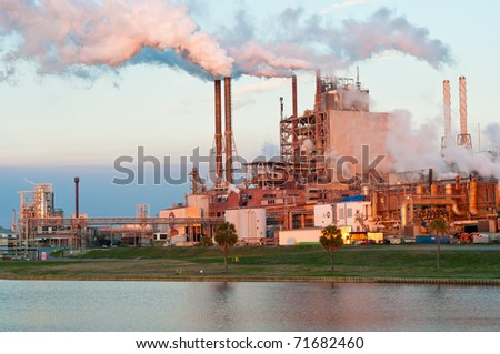 paper mill in the late afternoon light - stock photo