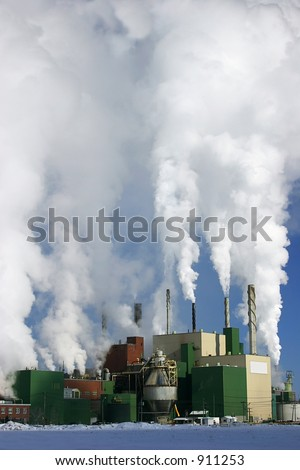 Paper Mill Producing a lot of Smoke - stock photo