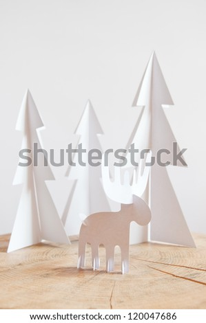 Paper moose in the paper forest - stock photo