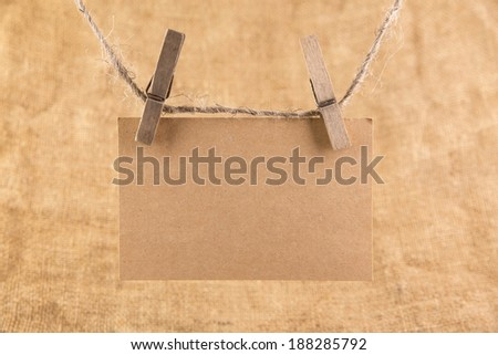 Paper nameplate on old sacking background - stock photo