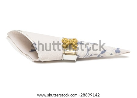 Paper napkin with gold bows on white background - stock photo