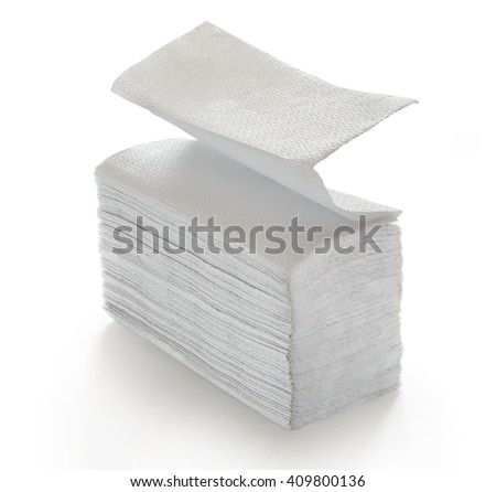 Paper napkins and towels in closeup on white - stock photo