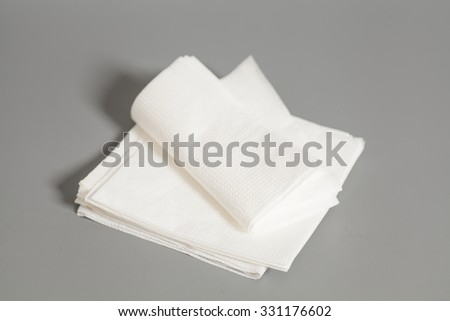 Paper napkins  on a gray background