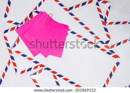 Paper note on airmail envelope - stock photo