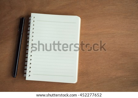 paper note,pen and phone in wood background - stock photo