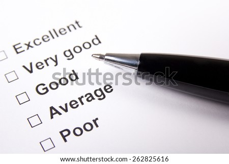 paper of survey with answers and metal pen - stock photo