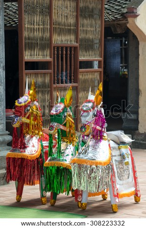 Paper Offering (to be burnt) at a temple outside Hanoi, Vietnam - stock photo