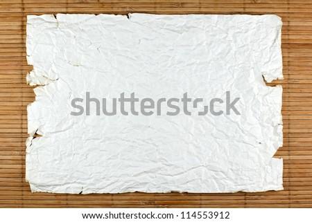 Paper on bamboo mat - stock photo
