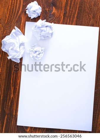paper on wooden background - stock photo
