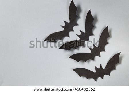 paper origami bats on a gray background, decorations for the holiday Halloween