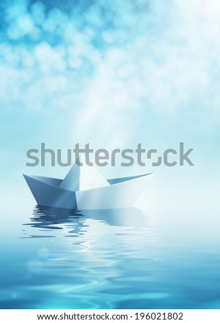 Paper origami boat on azure water - stock photo