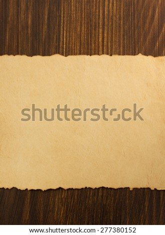 paper parchment on wooden background - stock photo