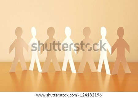 Paper-people holding hand - stock photo