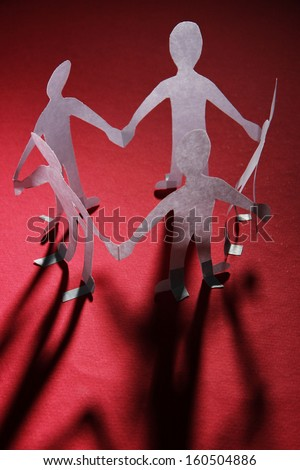 Paper people in social network concept on dark background - stock photo