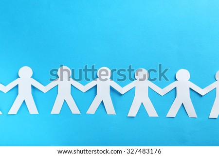 Paper people on the blue paper background