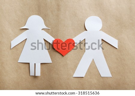 Paper people together in love on the paper background - stock photo