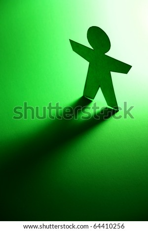 paper person cutout casting a shadow - stock photo