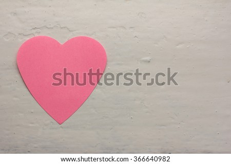paper pink heart against a white painted surface. Copy space. Free space for text, Close-up, top view - stock photo