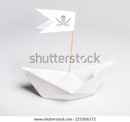 Paper pirate boat with flag and symbol - stock photo