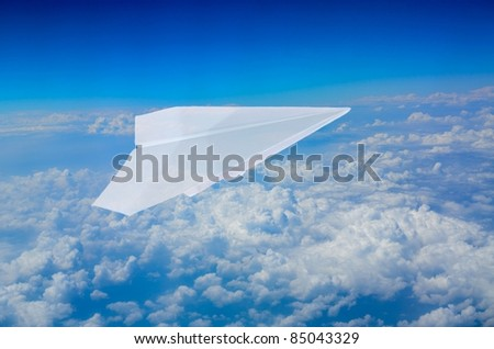 paper plane flying in sky background - stock photo