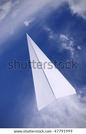 paper plane flying in the sky - stock photo