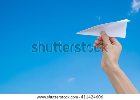 paper plane in a businessman hand on blue skies background