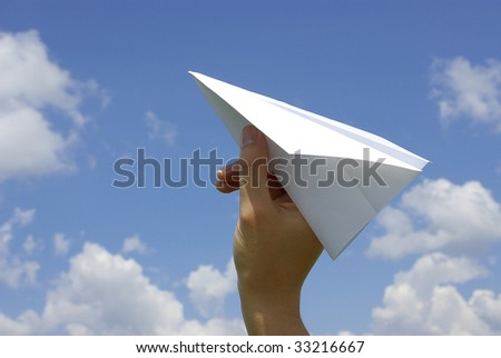 Paper plane on blue sky background