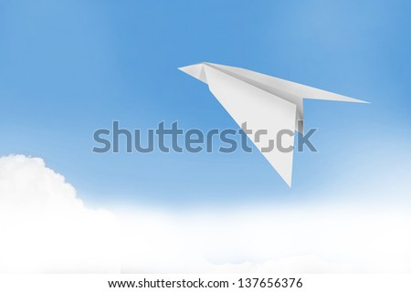 paper plane with blue sky background , business concept