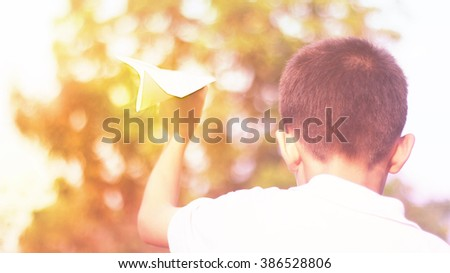paper planes and boy and sunset - stock photo