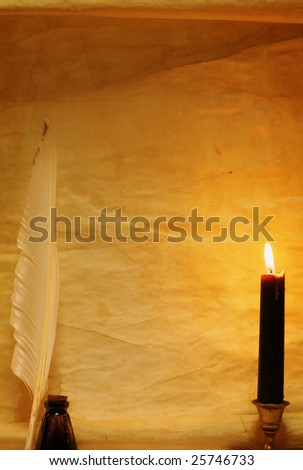 Paper, quill, & ink lit by candle - stock photo